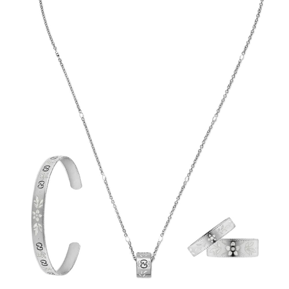 Тонкий незамкнутый браслет Gucci Icon из белого золота с тиснением и узором из эмали