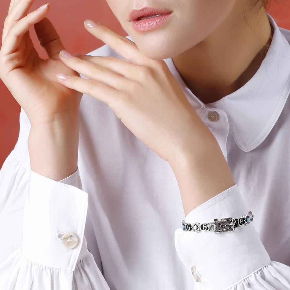 Женский браслет Gucci GG Marmont с цветочными мотивами