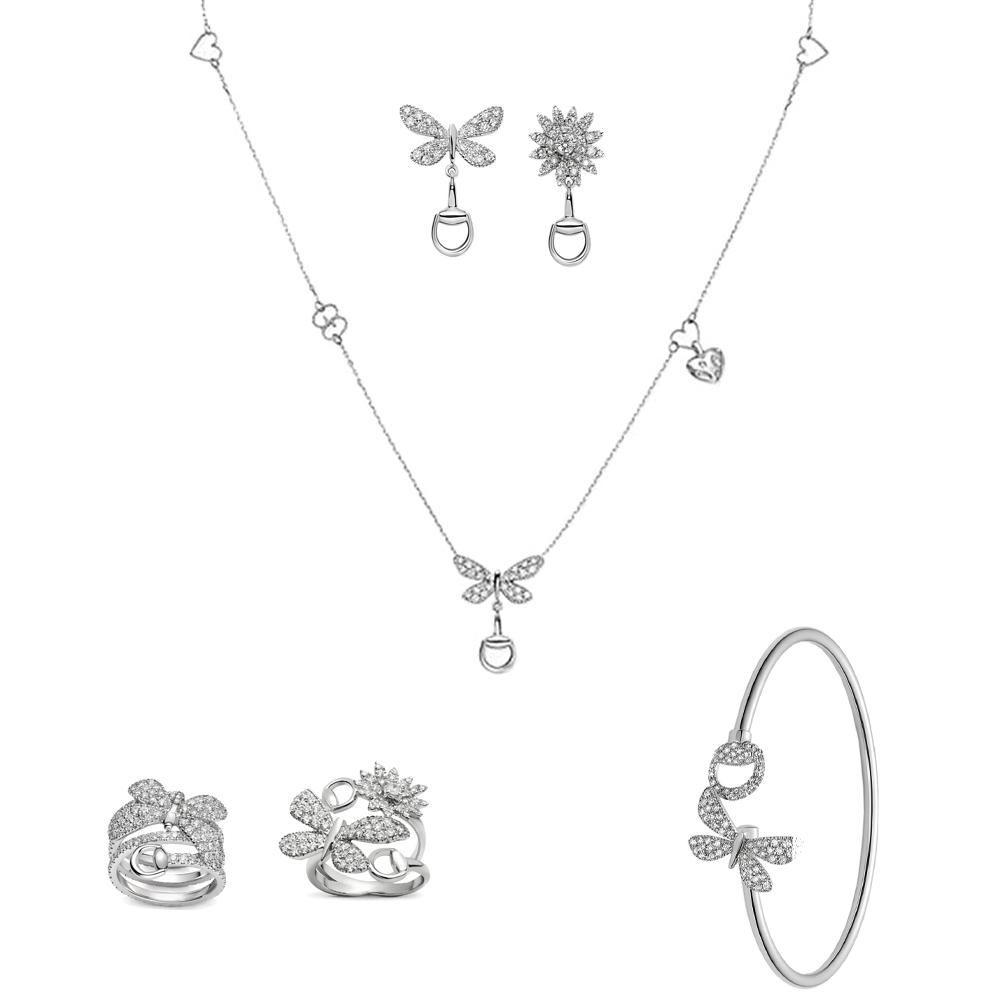 Серьги-гвоздики Gucci Flora из белого золота с бриллиантами в форме бабочки и цветка