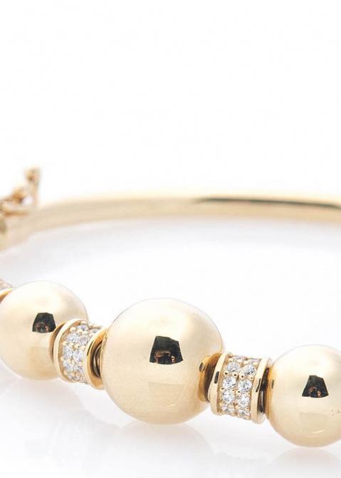 Золотой браслет с крупными шариками, фото