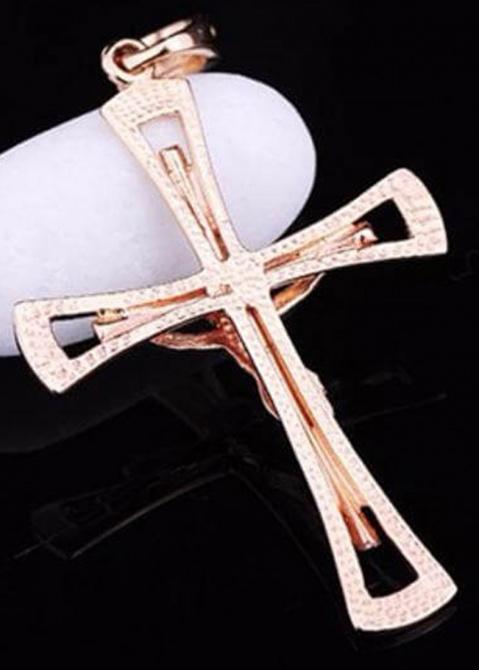 Крестик из золота на фигурной основе, фото