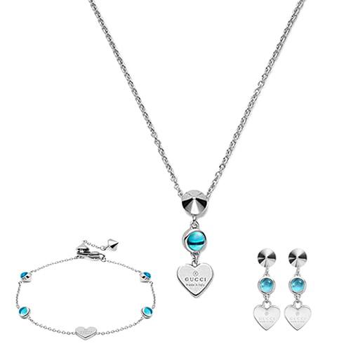 Тонкий браслет-цепочка Gucci Trademark с подвеской-сердцем и круглыми голубыми топазами, фото