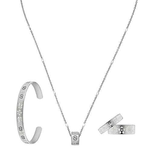 Тонкий незамкнутый браслет Gucci Icon из белого золота с тиснением и узором из эмали, фото